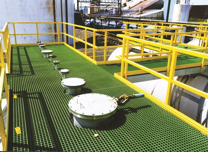 A view of an FRP walkway in an industrial facility.